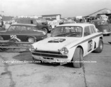 "Ford Cortina V8 ""Fraud Cortina"" Terry Sanger or Terry Drury Silverstone paddock c.1967"